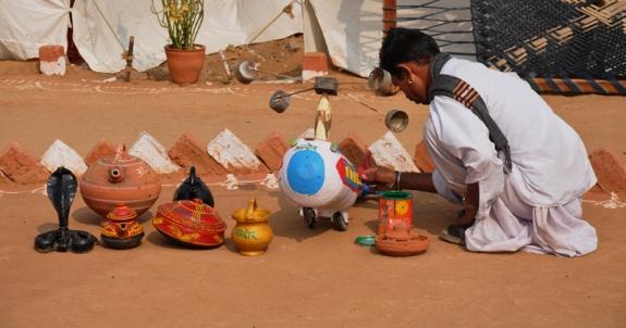 Village craft man display at sowing seeds 2010